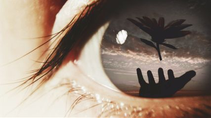 eye close-up vision hand flower