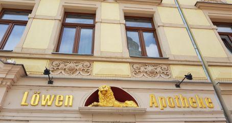 town house facade pharmacy lion