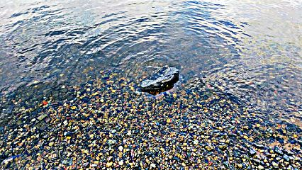 stone stones water ripple nature