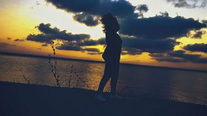 sunset shadow sky clouds sea