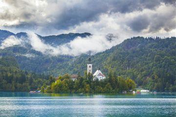 island church lake clouds fog
