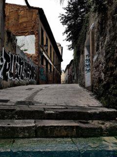 village street facade stone grafitti