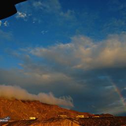 rainbow sunlight clouds sky blue