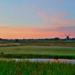 typicaldutch landscape windmill sunset