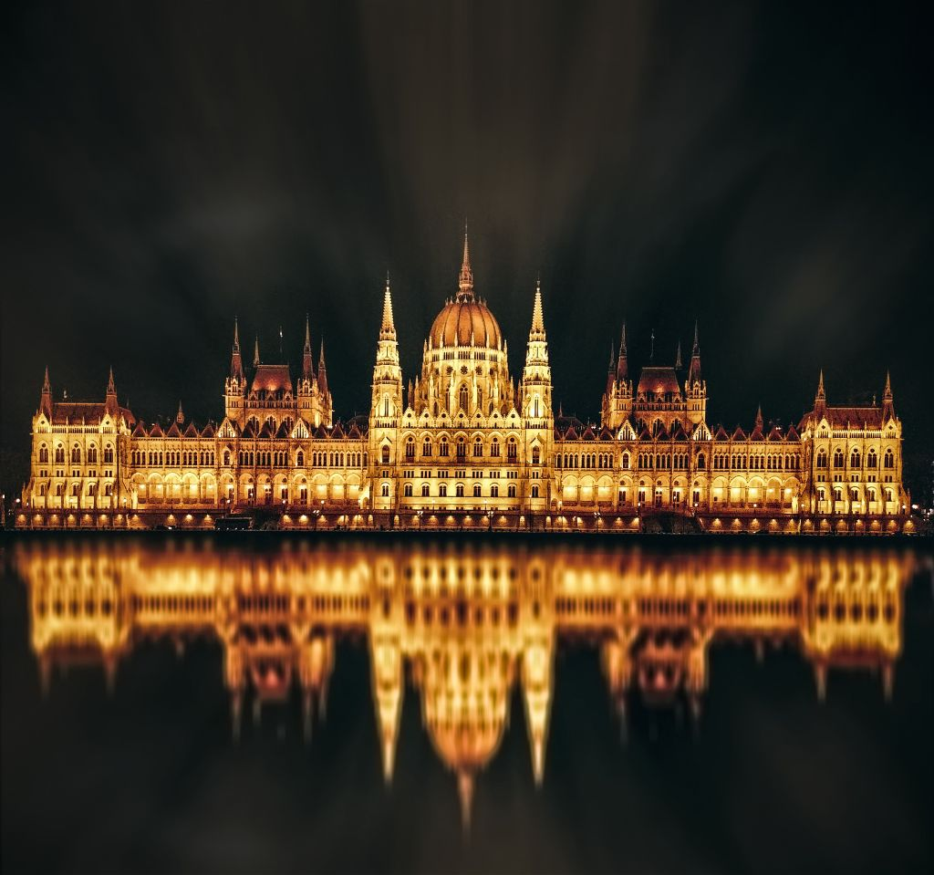 The Hungarian Parliament Building- the largest building in Hungary, with a height of 96 m (315 ft), width 123 m (404 ft) and length 268 m (879 ft). {Taken with LG G6} #historic #parliament #hungary #architecture #budapest #lights #reflection #water #river