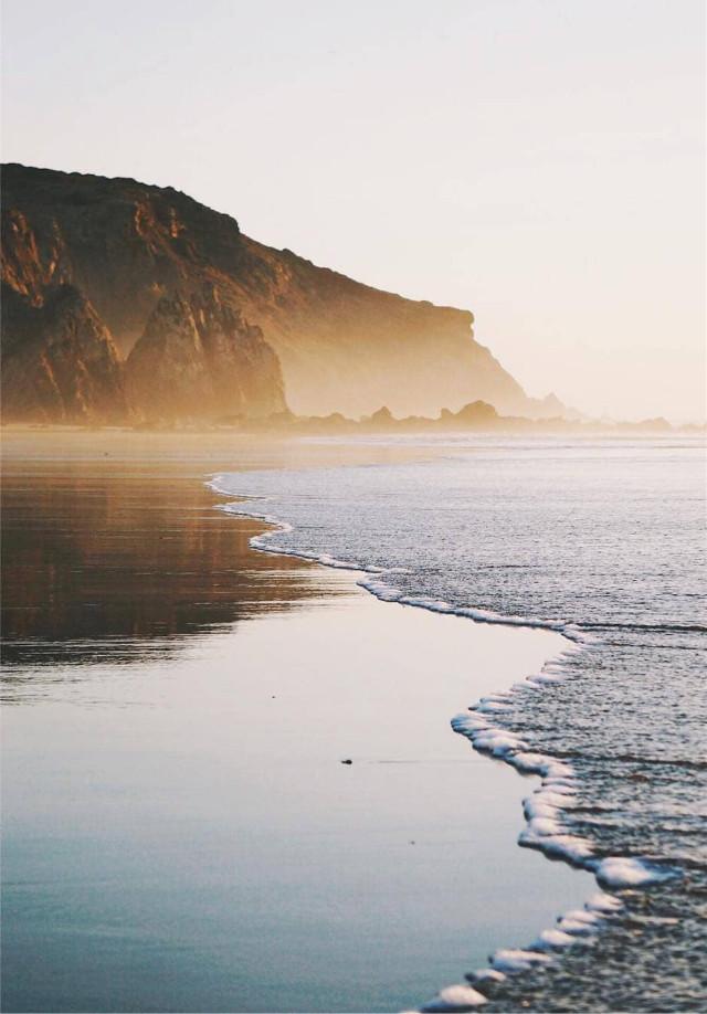 #beachmood #nature #beachview #seashore #lowtide #calmness #wavescrashing on #sand #calmwaves  #reflections on the #wetsand #rocks #cliffs #mistyhorizon #winterbeach #beautifulday #lowangleshot #beachphotography   #freetoedit  Enjoy your weekend my friends 🌞