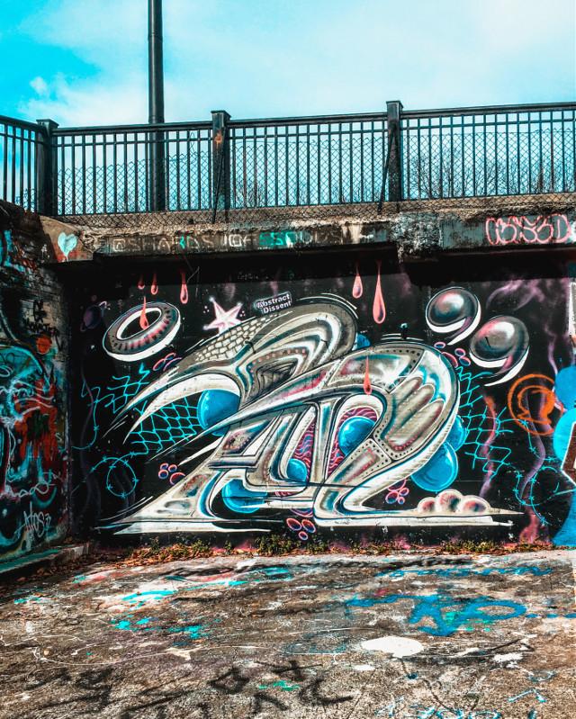 A local hidden gem... #graffiti #streetart #paint #art #artwork #graffitiart #graffitiwall #pavement #cement #spraypaint #blue #aesthetic #urban #pit #bluesky #clouds #college #street #lettering #freetoedit
