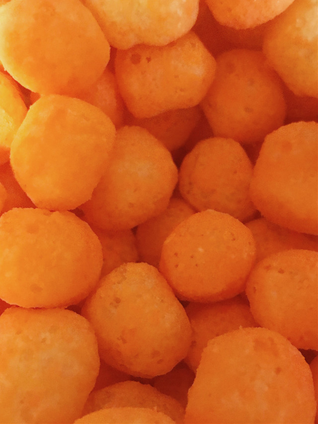 #cheesepuffs #orange #chips #snacks #cheeseballs #food #yum #upclose #bright #yummy #delicious #silly #interesting #photography #freetoedit