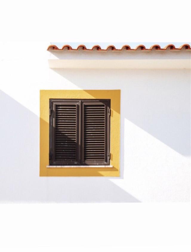 #urbanexploration #house #facade #whitewall #window #shutters #yellowframe #rooftiles #architecturaldetail #brightlight #sunnylightandshadows #minimalism #architecture #urbex #minimalphotography                                                                                                                                                 #freetoedit