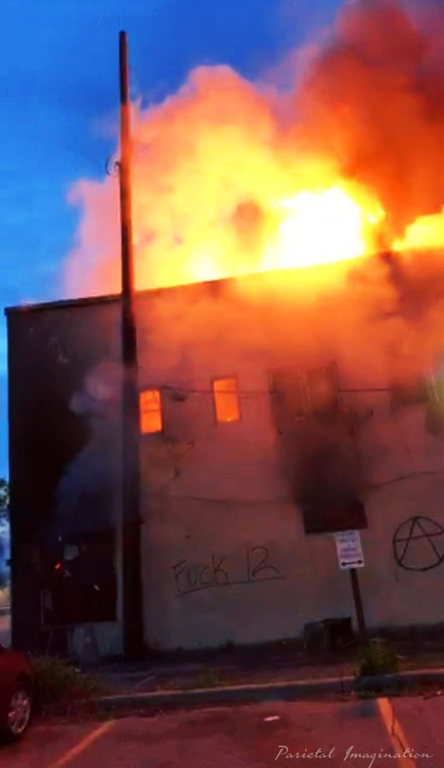 Business engulfed in flames during rioting in Minneapolis, Minnesota.  Photo by: Parietal Imagination Art @pa, May 27th, 2020 #minneapolis #minnesota #protests #riots #georgeflynn #donotedit #myphoto #myphotography #vip #parietalimagination