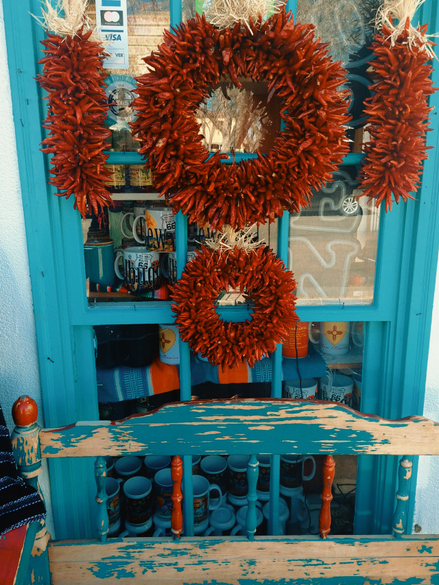 Iconic Southwest Colors Chile Ristras & Turquoise Colors are traditional in the Southwest.   #shopwindow #chileristras #chile #southwestcolors #turquoise #oldtown #albuquerque #newmexico #travel #myphotography