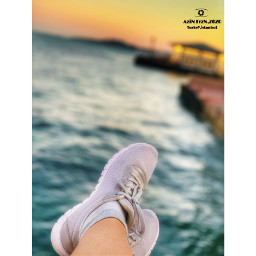 oneperson lowsection humanbodypart humanlegs water shoes sea outdoors day realpeople nature sunset