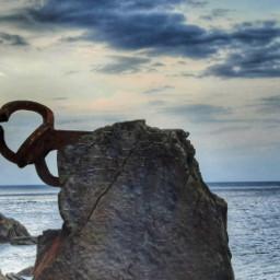 donostia peinedelviento sculpture sundown sea